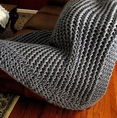 Free Knitting Pattern for Lacy Chunky Throw - Wenlan Chia's quick easy afghan for Classic Elite Yarns makes use of a very open lace pattern to keep down the weight (and yardage). Quick Knit in super bulky yarn. Pictured project by weedwacker