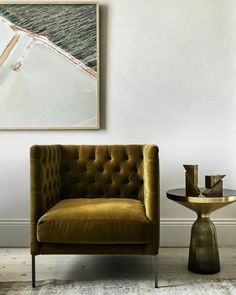 Olive green tufted velvet arm chair