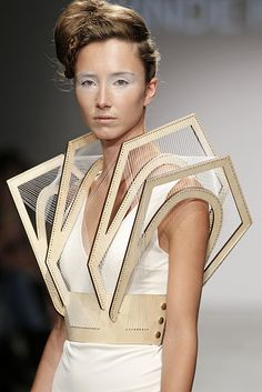 winde reinstra. i love the 3d shapes created with leather and thread. so architectural.