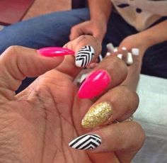 Pink, gold glitter, white and black pattern claw nails