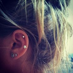 I love the idea of two cartilage piercings on one ear. I want this so bad. Four on one side and then an Industrial piercing on the other ear!!!