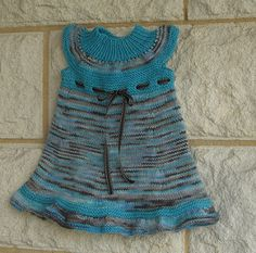 The top/dress is knitted completely in the round.