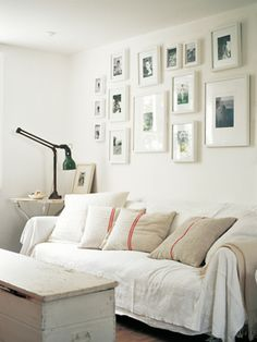 Lots of throw pillows for the couch that is opposite the bed. Like the pictures above this, too!