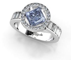 Blue diamond with channel-set halo and baguette side diamonds