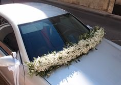 γιρλάντα αυτοκίνητου με γυψοφίλη και φύλλωμα ελιάς...Δεξίωση | Στολισμός Γάμου | Στολισμός Εκκλησίας | Διακόσμηση Βάπτισης | Στολισμός Βάπτισης | Γάμος σε Νησί & Παραλία. Plants, Wedding, Valentines Day Weddings, Plant, Weddings, Marriage, Planets, Chartreuse Wedding