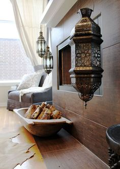 Moroccan lanterns hanging off the modern mantle...brilliant juxtaposition!