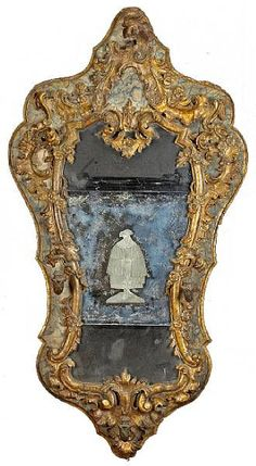 An important Italian Baroque painted and parcel gilt Girandole Mirror, Sicily, first half of the 18th century
