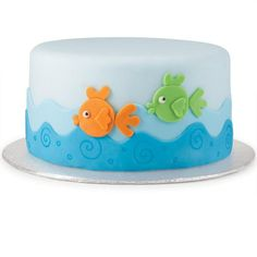 Fondant layering is easy and fun—as proven by this awesome fish-in-the-sea cake! For the wave effect, cut light and dark strips using the Cut-N-Spin Rotating Cutting Board to create the up-and-down edge with ease.