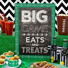 DIY a leaderboard for the snack table! All you need is a piece of black poster board, our green gridiron garland to border the sign & a creative football-themed saying to write on the board!