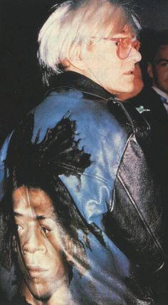 Andy Warhol wearing a jacket with Basquiat's face painted on the back.