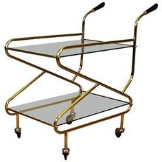 French Bar Cart from the 1950s | From a unique collection of antique and modern bar carts at https://www.1stdibs.com/furniture/tables/bar-carts/