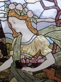 this is lovely stained glass with shading, designs within the glass. it is a large piece as you can see from the scale of my hand. it is trimmed with heavy leading. i had inherited it some time ago and i feel that the price is very low for the value of this piece. i love the cherry blossoms and the angelic look the girl has. the detail is amazing. priced low and firm at only $7