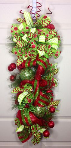 Actual length of the swag measures 37 inches. Designed with mesh, ribbons, and all the trimmings! All wreath materials are wired or/and glued with Christmas Swags, Christmas Mesh Wreaths, Grinch Christmas, Christmas Door, Christmas 2014, Door Swag, Xmas Decorations, Decoration Noel, Deco Wreaths