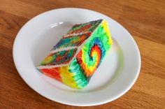 Peace, love and cake! Learn to make a tie-dye cake with colorful batter and decorate the fondant-covered cake with gel food coloring.