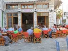 Old men playing backgammon in the main town of Chora, Antiparos Isle, Greece.