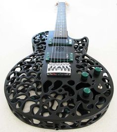 The Atom 3D printed guitar: A Les Paul inspired guitar with an internal atom with spinning electrons. The bodies are printed, using Selective Laser Sintering, by 3D Systems in the USA, on an sPro 230 SLS system. The material being used for these guitars is Duraform PA which is a very strong form of Nylon.