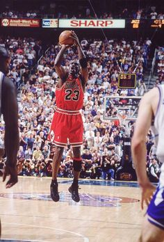SI's 100 Best Michael Jordan Photos \\ Jordan pulls up for his game-winning jumper to beat the Utah Jazz in Game 6 of the 1998 NBA Finals and clinch the championship.