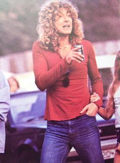 Robert Plant and young daughter Carmen Jane holding his hand