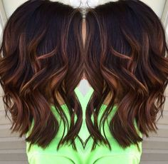 Dark-toned balayage with deep chocolate roots dropping down to caramel and honey pieces.
