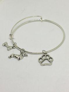 Basset Hound charm bangle bracelet by Pinkarrowheadranch on Etsy https://www.etsy.com/listing/511323722/basset-hound-charm-bangle-bracelet