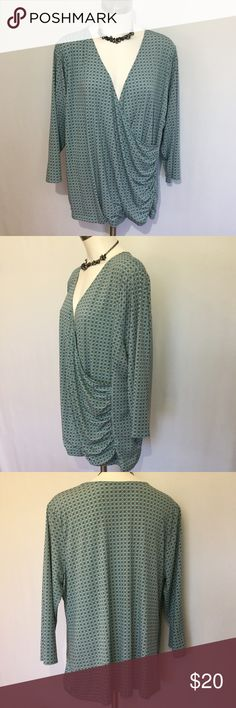 Liz Claiborne Top ➕ Liz Claiborne Woman Top in size 2X. 3/4 sleeves. Pretty light green, white & navy /black geometric design. Cute wrap style top in soft stretchy fabric. Hard to tell if it is black or navy. Would work good with both.  Excellent condition. Perfect for Spring & Summer.  Measurements across front laid flat & un-stretched at: armpit 24 1/2, waist 23 1/2, across bottom hem 26 1/4. Length from shoulder seam to bottom hem 26. Length from back collar seam to bottom hem 25 1/2…