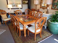 This glass top pine dining table with 10 chairs and 2 leaves is $1195.