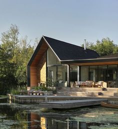 Platform 5 Architects completes shingle-clad home overlooking a private lagoon Modern Architecture House, Residential Architecture, Architecture Design, Wooden Barn Doors, Clad Home, House Built, Exterior Design, House Design, Villa Design