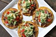 Easy recipe for the most delicious Carnitas Tostadas with Pineapple Guacamole- a family favorite dinner recipe!