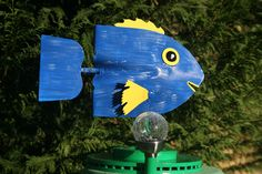 Fish on base with added solar light