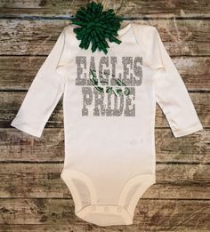 A personal favorite from my Etsy shop https://www.etsy.com/listing/256994995/philadephia-eagles-football-onesie-baby