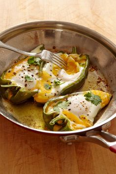 "Eggs in Pepper Boats Recipe - Jacques Pepin - ""One day I decided to cook eggs in sweet peppers with a bit of cheese and cilantro. It made a great lunch dish. I used the long, pale green peppers sometimes called banana peppers. Poblano and cubanelle pepper Egg Recipes, Brunch Recipes, Mexican Food Recipes, Vegetarian Recipes, Cooking Recipes, Healthy Recipes, Recipies, Healthy Treats, Cooking Ideas"