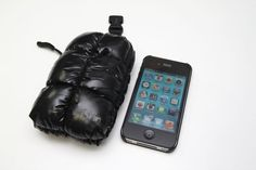 "iPhone case called ""iSkin Lil Keeper"". Just like down jacket...funny."