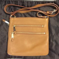 Cole Haan Cross Body Purse Light Brown Leather Cross body adjustable Cole Haan Leather purse with orange interior satin. No stains or rips. Main inside pouch can hold wallet & much more. Purse has side zippers to slightly expand if needed. To additional front pockets with orange satin interior. Deep pockets that go length of purse. Slight used but like new.  5 notches to adjust the strap. Purse was stored in cotton bag to keep from any damage. Cole Haan Bags Crossbody Bags