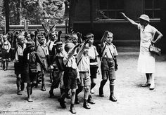 Germans who grew up with Nazi propaganda at school are still more racist than those who grew up before or after the Third Reich, a new study claims. A disturbing image of a German primary school teacher instructing children to learn the Nazi salute is shown
