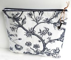 A large zipper pouch made with vintage Sanderson Andromeda fabric (black and white flowers and brances). Lined in soft black and white striped cotton and finished with a leather pull with vintage key. Size - about 36.5cm by 32cm.  A good sized zip pouch in a beautiful monochrome Sanderson print. Great for holding make up, sewing or knitting projects, gadgets, letters or keepsakes, or to use when travelling to hold items in your suitcase (e.g. underwear).  Handmade by me in my sewing studio…