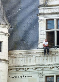 Guy on a ledge at Chateau du Chenonceau, Loire Valley, France