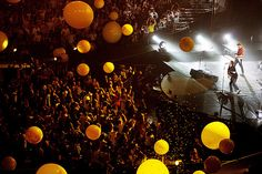 This was one of the best concerts I have ever been too, oh, about 6 years ago. We were in about the 5th row. Amazing. I didn't take this photo, nor was I at this specific concert, but I remember when they threw all of the yellow balls out into the crowd. It was magical. Coldplay is awesome live, if you ever get the chance to go...