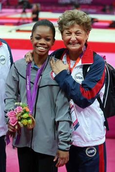 Gabrielle Douglas of the United States celebrates winning the gold medal with team coordinator Martha Karolyi after the Artistic Gymnastics Women's Individual All-Around final on Day 6 of the London 2012 Olympic Games at North Greenwich Arena on August 2, 2012 in London, England. (Photo by Streeter Lecka/Getty Images)