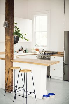 Vintage bar stools, hanging flower pot in kitchen from Flora Grubb, hanging candle holder from Ikea. Meet Courtney Klein