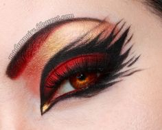 Black and red makeup. Reminds me of a phoenix.