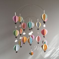 These soft pastel shades makes a wonderful gift to celebrate the arrival of a new baby.  ♥ If you are the sort of person who likes flexibility then this is for you. I have designed the hanging mechanism so that you can choose the height that the decorative garlands are positioned. ♥ Slot the stainless steel hangers anywhere along the length of the hanging chain. ♥ You have the option of hanging the garlands higher up for a nursery so those little hands can't reach! Or positioning the…