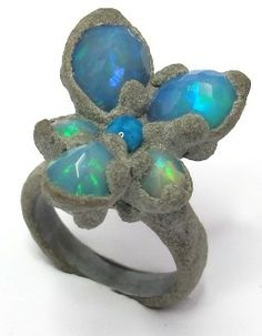 Viola Opal Ring, made of  cement, silver, and wood and of course OPALS!!! Such a cool piece! Wow!
