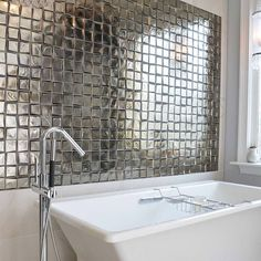 A #shiny #glass #mosaic #tile #featurewall creates a sophisticated backdrop for the soaking tub in this #bathroom. This #metallic goodness comes from @crossvilleinc.  / #tiletuesday  #tilelove #instahome  #tileaddiction #mosaics #backsplash #backsplashideas #instadecor #tiles #tiled #tiling #tilework #interior #interiors #interiordesign #interiordesigner #interiorinspiration #idcdesigners #tiler #bathroomdesign #walltiles by tiletuesday