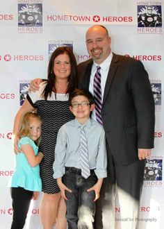 Ken Palmer, one of the night's honorees, posing with his lovely wife and their two children.
