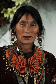 A Konyak Naga lady adorned in traditional finery. (Nagaland, NE India)