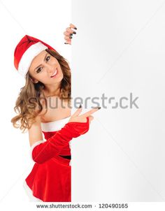Isolated young christmas woman presenting - stock photo