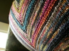 Noro Silk Garden in 3 or 4 colorways, plus one ball of Manos del Uruguay in Wildflowers.  Size 9 needles.  Pattern: simple yet effective shawl from cosmicpluto.