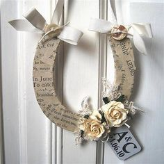 Our handcrafted horseshoe is a beautiful good luck token to give to the couple on their special day. Each horseshoe is made to order and covered with vintage papers, embellished with pretty paper roses and finished with a ribbon hanger. The horses. Bridal Horseshoe, Horseshoe Crafts, Horseshoe Art, Lucky Horseshoe, Decopatch Ideas, Good Luck Horseshoe, Wedding Crafts, Wedding Ideas, Chic Wedding