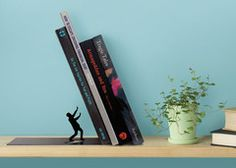 When your books are unbalanced and in danger of toppling, the stalwart metalic hero of this bookmark will prevent your books from falling ov...