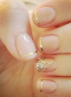 Simple Nails | Nude with golden stripes and glitter accent nail.